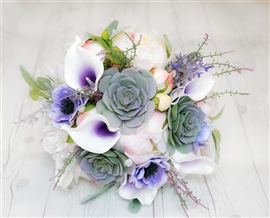 Boho Rustic & Woodlands Theme Bouquet, made with Natural Touch Succulents, Callas and Peonies in a Lilac, Purple and Blush color mix.
