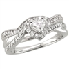 Heart shaped diamond engagement ring with shadow band