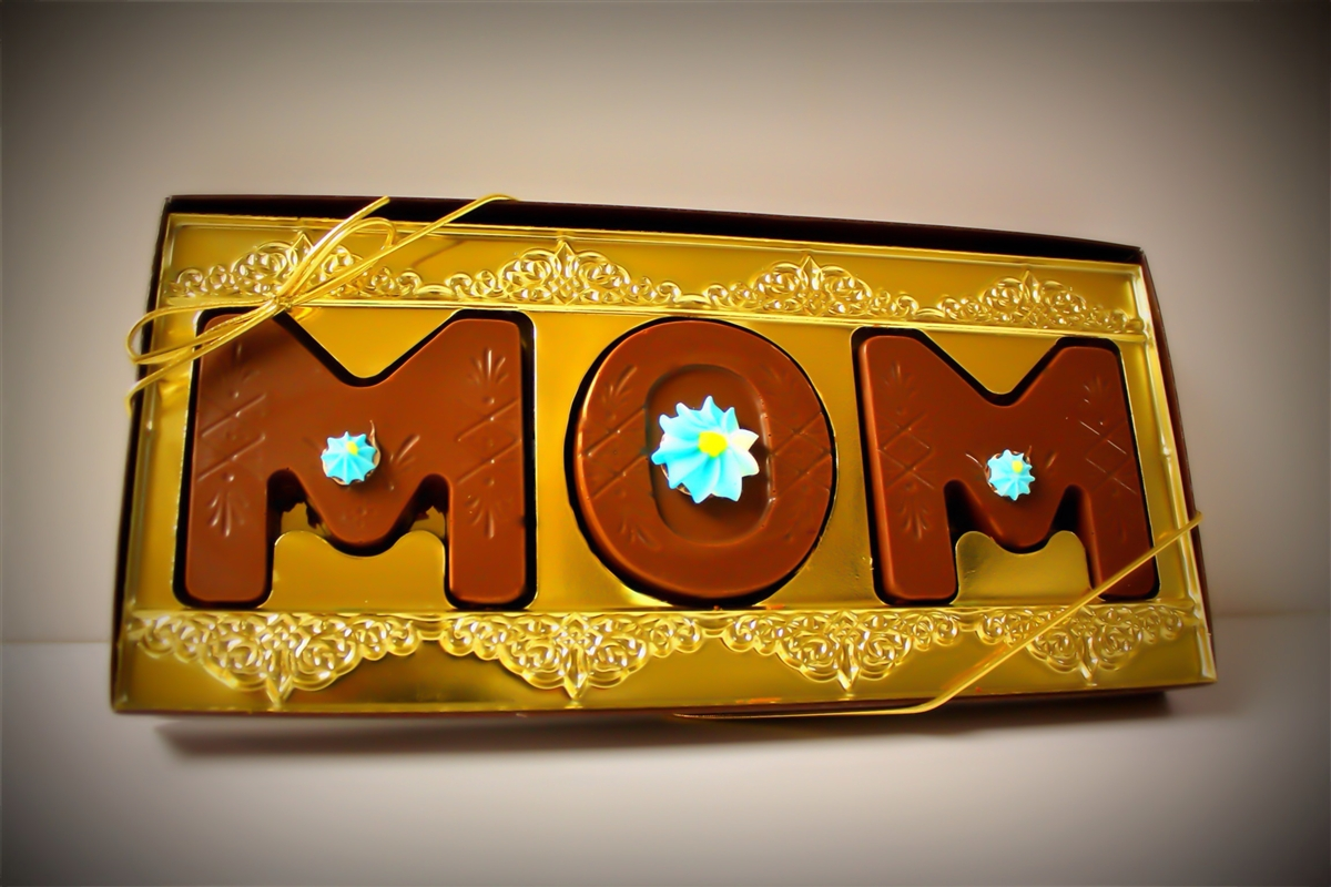 our solid chocolate letters in a gift box spell  u0026quot mom u0026quot