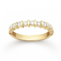 This classically designed 14k yellow gold diamond wedding band features one half carats of round brilliant diamonds in a unique yellow gold setting.