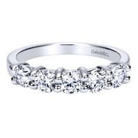 Round brilliant diamonds fill this 14k white gold wedding band with 0.99 carats of diamond shine.