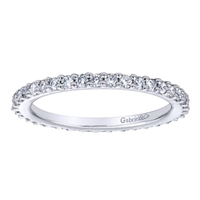 This 14k white gold diamond eternity band uses over one half carats of round brilliant diamonds to wrap around 14k white gold in this never-ending diamond band!