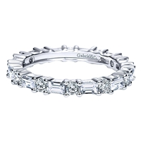 With round and baguette cut diamonds, this 1.25 carat eternity band set in 14k white gold is a delightfully unique piece of wedding jewelry.