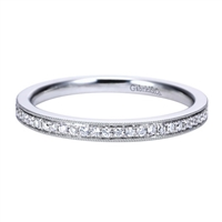 This 14k white gold diamond wedding band is simple but flashes elegantly with beaded white gold rows surrounding channel set round diamonds.