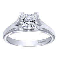 This white gold or platinum engagement ring fits a princess cut diamond and features a split shank, with a classic and traditional solitaire look.