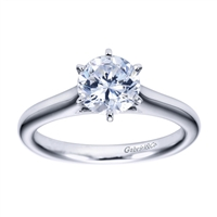 White gold or platinum bands rise towards the center of this solitaire engagement ring with a contemporary finish.