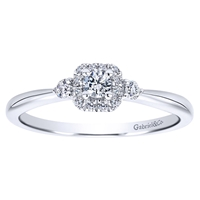 This 14k white gold petite diamond halo engagement ring is studded with 0.19 carats in round brilliant diamonds is a simple and sleek diamond engagement ring that makes a clear message.