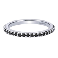 This unique 14k white gold stackable ring shimmers with round black diamonds set in an eternity style .