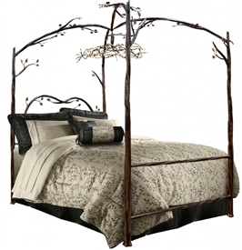 Pictured here is the enchanted Forest Canopy Bed Hand-Forged by Stone County Ironworks.