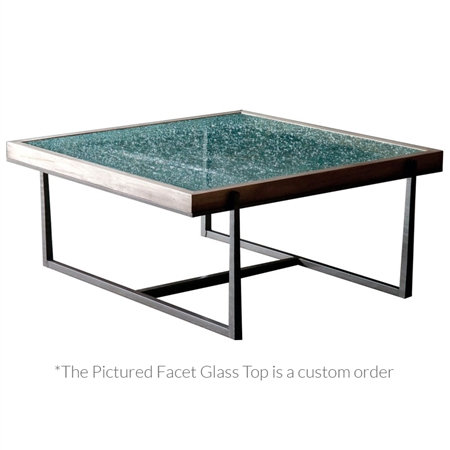 Pictured is the 54-inch square transitional style Cooper cocktail table with hand-forged table base and thick wood slab table top from Charleston Forge.