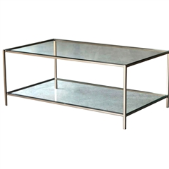 Pictured is the Covina Cocktail Table which measures 47-in by 28.5-in by 19.25-in with custom iron finishes and table top options to choose from.