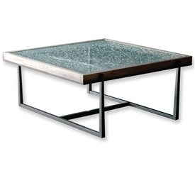 Pictured is the Cooper Square Cocktail Table which measures 44-in by 42-in by 21.25-in with custom iron finishes and table top options to choose from.