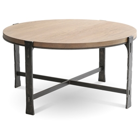Pictured here is the Woodland Round Cocktail Table with a Burnished Iron finish on the table base and a drift wood oak top.
