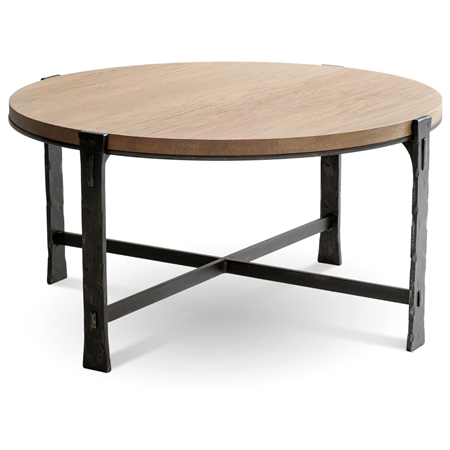 Pictured is the 42-inch round Transitional style Woodland cocktail table with hand-forged iron base and thick wood slab table top from Charleston Forge.