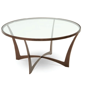 Pictured is the Round Lotus Cocktail Table which measures 36.75-in diameter and 18.75-in high. Available in several custom iron finishes and table top options.
