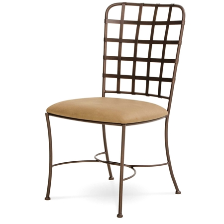 Pictured here is the Manchester Iron Dining Arm Chair with upholstered seat by Charleston Forge.