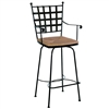 Pictured here is the Etrusche Swivel Bar Stool with Arms with hand forged quality craftsmanship with fine iron finishes and upholstery options to choose from.