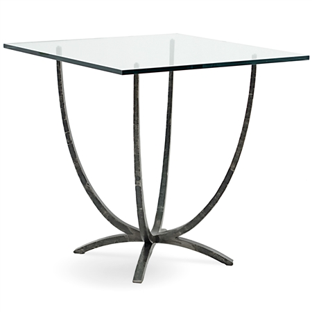 Pictured is the 54-inch square transitional style Triumph Dining table with hand-forged iron table base and glass table top from Charleston Forge.