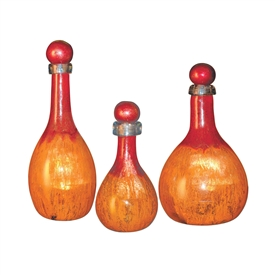 Pictured here is the Orange Glow Set of 3 Glass Bottles with Tops from Couleur