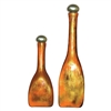 Pictured here is the Feather Gold Glass Bottles Set of 2 from Couleur
