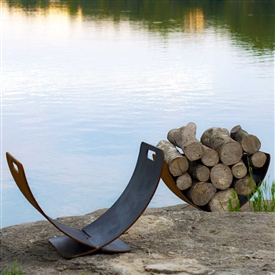 Wings of Flight Fire Wood Holder atistically Hand-crafted by Fire Pit Art and sold at TimelessWroughtIron.com