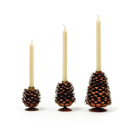 Pictured here is the set of 3 Progressing Pinecones Candle Holders.