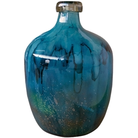 Pictured here is the hand blown Turquoise Big Glass Bottle manufactured by Mathews and Company.