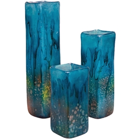 Pictured here is the hand blown Turquoise Square Glass Vases Set of 3 manufactured by Mathews and Company.