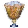 Pictured here is the Orange Passion Ruffle Glass Vase from Mathews and Company