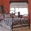 Pictured here is the Alexander Wrought Iron Bed hand forged by artisan blacksmiths.
