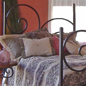 Pictured here is the Alexander Wrought Iron Headboard hand forged by artisan blacksmiths.