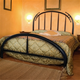 Pictured here is the Pinnacle Wrought Iron Bed hand forged by artisan blacksmiths.