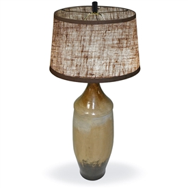 Pictured is our Contemporary style Bell Table Clay Lamp with Skyes Finish  hand-made by Mathews & Co.