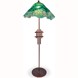 Pictured is our modern style Metropolis Floor Lamp with Glass Shade hand-made by Mathews & Co.