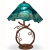 Pictured is our Rustic style wrought iron San Saba Table Lamp with Large Glass Shade hand-made by Mathews & Co.
