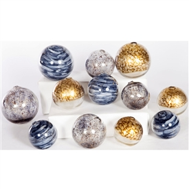 Pictured is an assortment of 12 Glass Spheres in random sizes and colors including Mythic, Driftstone and Glimmer.