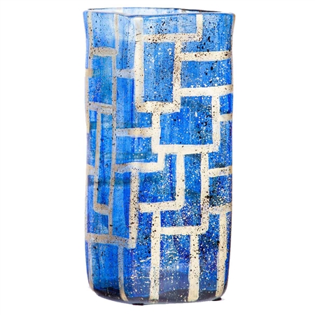 Pictured here is the Small Sapphire Glass Vase, hand-made from recycled glass.