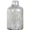 Pictured here is the Oyster Shell Small Glass Vase, hand-made from recycled glass.