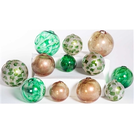 Pictured is an assortment of 12 Glass Spheres in random sizes and colors including Wrinkled Currier Gilt, Algae Bloom & Aquatic Emerald.