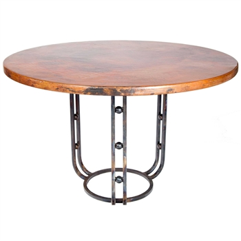 "Pictured here is the Clayton Dining Table with Wrought iron base and 54"" Round Hammered Copper Table Top"