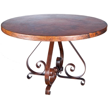 "Pictured here is the Pierre Dining Table with Wrought iron base and 48"" Round Hammered Copper Table Top"