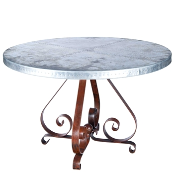 "Pictured here is the Pierre Dining Table with Wrought iron base and 48"" Round Hammered Zinc Table Top"
