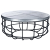 Pictured here is the Axel Coffee Table with Wrought iron base and Round Hammered Zinc Table Top