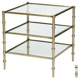 Pictured is the Trivecta Accent Table which features a Glass table top and an iron/Brass/Aluminum frame with your choice of Polished Nickel or Antique Brass finish options by Prima that measures 24.25-in x 24.25-in x 26-in