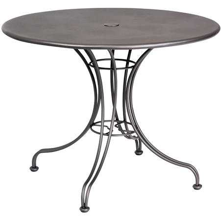 "Pictured is the Solid Iron Top 36"" Round Umbrella Table from Woodard Outdoor Furniture, sold by Timeless Wrought Iron."