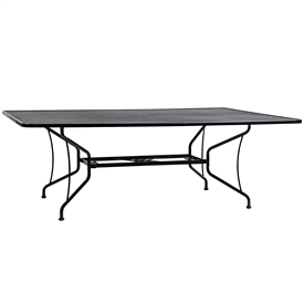 "Pictured is the Mesh Top 60"" x 84"" Umbrella Dining Table from Woodard Outdoor Furniture, sold by Timeless Wrought Iron."
