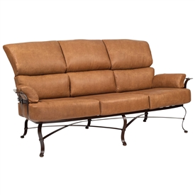 Pictured here is the Atlas Outdoor Sofa with upholstered all-weather seat cushions from Woodard.