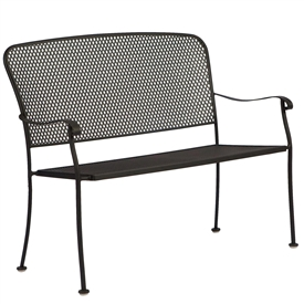 Pictured is the Fullerton Stackable Bench from Woodard Outdoor Furniture, sold by Timeless Wrought Iron.