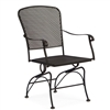 Pictured is the Fullerton Coil Spring Dining Chair from Woodard Outdoor Furniture, sold by Timeless Wrought Iron.
