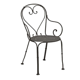 Pictured is the Parisienne Pattern Metal Seat Arm Chair from Woodard Outdoor Furniture, sold by Timeless Wrought Iron.